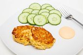 foto of crab-cakes  - Fresh crab cakes on a white plate with sauce - JPG