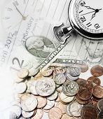 Clocks, banknotes and coins. Time is money concept