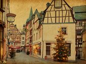 Christmas Eve in Bernkastel-Kues, Germany.  Photo in retro style. Added  paper texture.