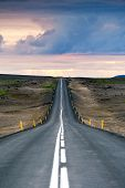 Iceland, Husavik, road 87. Ondulated and empty road in the sub-artic icelandic landscape. Travel, ex