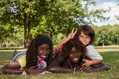 Multi Ethnic Children And Peace Sign