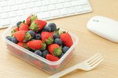 Berry mix lunch box in working desk