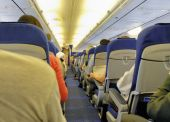 pic of flight attendant  - The interior of a commercial airplane with passengers - JPG