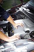 image of internal combustion  - Auto mechanic working in garage - JPG