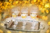 Six champagne flutes on gold shiny background
