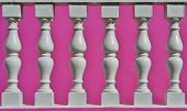 image of balustrade  - Close up of white Precast Balustrades with pink house wall - JPG