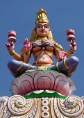 stock photo of lakshmi  - Goddess Lakshmi on top of the entrance gate at Sripuram the Golden Temple in Vellore Tamil Nadu India - JPG