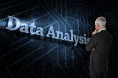 The word data analysis and thoughtful businessman standing back to camera against futuristic black a