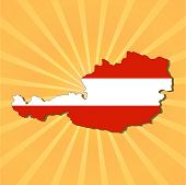 Austria map flag on sunburst vector illustration