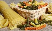 Raw colored pasta fusilli close up