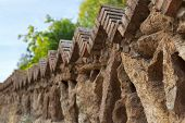 stock photo of old stone fence  - Fence of old stones in a park in Barcelona Spain. ** Note: Visible grain at 100%, best at smaller sizes - JPG
