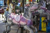 image of carousel horse  - Carousel Horses at an amusement park during the day - JPG