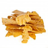 picture of nachos  - Salted corn chip nacho snack with cheese sauce isolated on white background - JPG