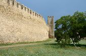 stock photo of fortified wall  - Fortified wall and watchtower in old turkish fortress Akkerman on the river Dniester in Belgorod - JPG