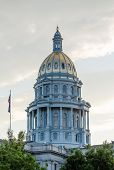 foto of granite dome  - The gold leaf covered dome of the State Capitol Dome in Denver Colorado shortly after sunrise