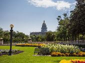 picture of granite dome  - Flower beds and gardens of Civic Center Park with the gold leaf covered dome of State Capitol of Colorado in background - JPG