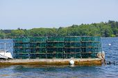 foto of lobster boat  - Lobster traps at a fishing pier on Littlejohn Island Yarmouth Maine New England - JPG