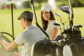 picture of caddy  - Young couple playing at golf cart at sunny day - JPG