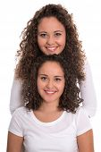 stock photo of identical twin girls  - Real monozygotic twins with natural stop curls isolated over white background - JPG