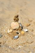 picture of beach shell art  - Sandcastle with stones and shells on the beach - JPG