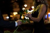 stock photo of fiance  - Woman getting rose on the first date - JPG