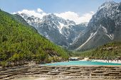 image of jade  - White Water River waterfall and Jade Dragon Snow Mountain Lijiang Yunnan China - JPG