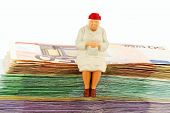picture of bill-of-rights  - figure of an old woman sitting on a stack of bills - JPG