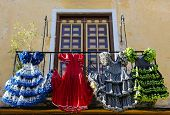 image of traditional dress  - Traditional flamenco dresses at a house in Malaga Andalusia Spain - JPG