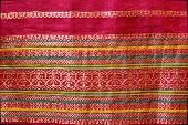 stock photo of sari  - Golden thread design work on red border of Indian Silk Sari - JPG