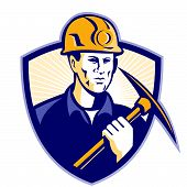stock photo of ax  - Illustration of a coal miner holding a pick ax facing front set inside shield done in retro style - JPG