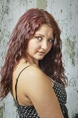 stock photo of wench  - View of young attractive girl with long red hair - JPG