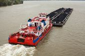image of barge  - Top view of Tugboat pushing a heavy barge on the river - JPG