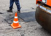 picture of road construction  - Road roller and traffic cone on the road construction - JPG