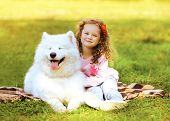 image of happy dog  - Happy child and dog resting on the grass in warm sunny day - JPG