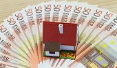 picture of plastic money  - Mini plastic house on Euro banknotes - JPG