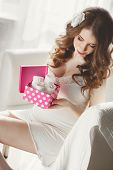 stock photo of nightgown  - Beautiful young pregnant woman in a white nightgown - JPG