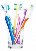 picture of toothbrush  - five toothbrushes and interdental brush in clear glass  - JPG