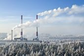 stock photo of thermal  - Thermal power plant with smoking chimneys in the background of the city - JPG