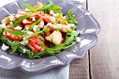 foto of rocket salad  - Chicken rocket feta and tomato salad on plate - JPG