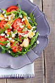 image of rocket salad  - Chicken rocket feta and tomato salad on plate - JPG