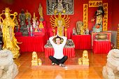 picture of woman dragon  - Young woman praying and meditating buddha near temple Thailand Phuket - JPG