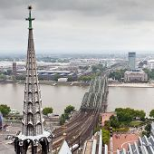 foto of koln  - View of Cologne, Germany. Gothic cathedral and steel bridge over river Rhine ** Note: Soft Focus at 100%, best at smaller sizes - JPG