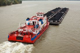 stock photo of barge  - Top view of Tugboat pushing a heavy barge on the river - JPG