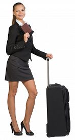 picture of passport cover  - Businesswoman with wheeled travel bag - JPG