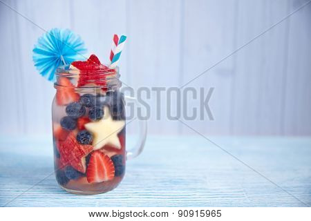 Cocktail with strawberry, blueberry and apple