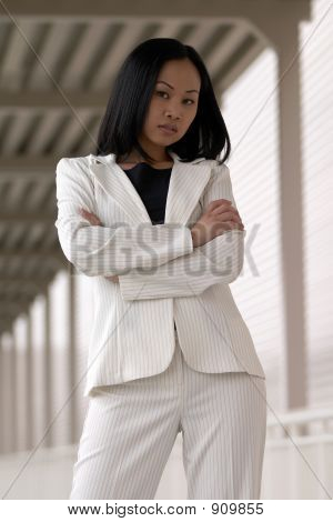 Picture or Photo of Asian business woman with folded arms in white suit