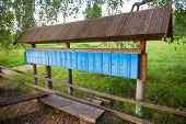 picture of mailbox  - Old rusted blue mailboxes in a row small Russian village - JPG