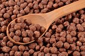 pic of chocolate spoon  - Chocolate cereal balls in a wooden spoon - JPG