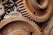 pic of machinery  - Old rusty gears of a steel machinery - JPG