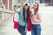 picture of  friends forever  - Hipster girlfriends taking a selfie in urban city context - JPG